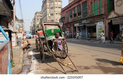 KOLKATA - NOVEMBER 28: Rickshaw man waits for the customers on the streets on November 28,2012 in Kolkata, India.Kolkata is the only city in India still having these hardworking human rickshaw workers