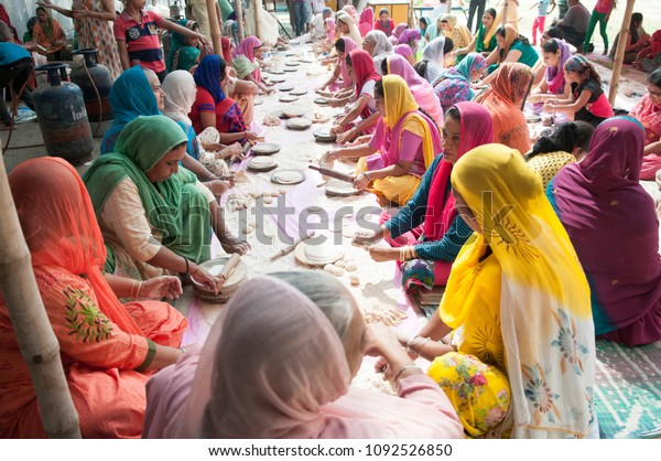 """KOLKATA- NOVEMBER 6: Women volunteers collectively making """"roti""""during a Langar or community kitchen service which in Sikhism refers to free meal for all  on 6th November, 2014 in Kolkata, India"""