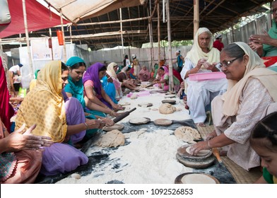 KOLKATA- NOVEMBER 6:Women volunteers cooking together during a Langar or community kitchen service which in Sikhism refers to free meal for all  on 6th November, 2014 in Kolkata, India