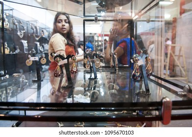 KOLKATA- NOVEMBER 9: A buyer negotiating with the seller during a jewellery trade show in India -India is one of the largest markets for gold on 9th November, 2014 in Kolkata, India.