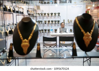 KOLKATA- NOVEMBER 9: A shop owner sitting in his shop waiting during a jewellery trade show in India -India is one of the largest markets for gold on 9th November, 2014 in Kolkata, India.