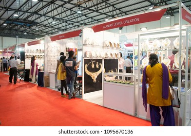 KOLKATA- NOVEMBER 9:Indian women checking gold jewelleries during a jewellery trade show in India -India is one of the largest markets for gold on 9th November, 2014 in Kolkata, India.