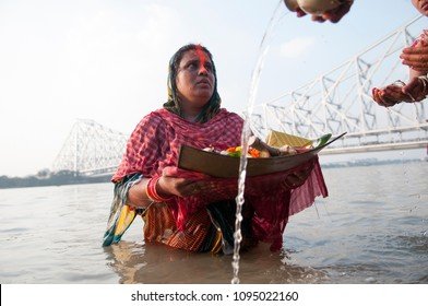 KOLKATA- OCTOBER 29: An Indian woman  offering her prayers during the Chhath Puja festival- A Hindu festival dedicated to the Sun God  29th October, 2014 in Kolkata, India.
