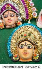 "KOLKATA - SEPTEMBER 26: Masks of Indian gods and goddesses during  the ""Tant"" saree Fair - A traditional Bengali saree  made in West Bengal and Bangladesh on September 26 2014 in Kolkata, India."