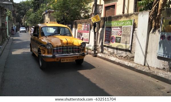 KOLKATA, WEST BENGAL, INDIA - 15 APRIL, 2017: Beautiful Yellow taxi at street in Kolkata city.