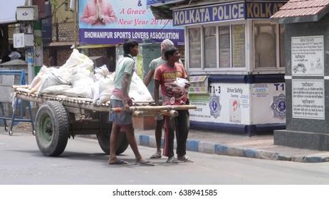 KOLKATA, WEST BENGAL, INDIA - 16 APRIL, 2017: An unidentified Indian poor cart puller at street.