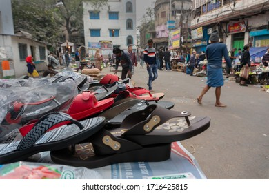 Kolkata, West Bengal, India - 16th December 2018 : Shoes are put up on roadside wheel cart for sale. At Territy Bazar, Kolkata.
