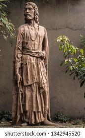 Kolkata, West Bengal, India - 19 March 2019: A statue of young Rabindranath Tagore at Rabindra Sarovar Lake