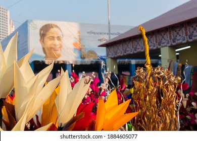 Kolkata, West Bengal, India - 31st December 2018 : Artificial flowers made out of colored spongewood, on display for sale during Handicraft Fair. Smt. Mamata Banerjee's smiling face in background.