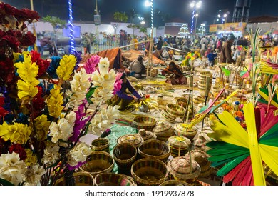 Kolkata, West Bengal, India - 31st December 2018 : Cane made artificial colored flowers and plants, baskets, handicrafts for sale in Handicraft Fair in Kolkata- the biggest handicrafts fair in Asia.