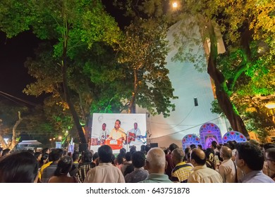 KOLKATA, WEST BENGAL , INDIA - 9TH MAY 2017:Male singer performing and seen in a giant screen amongst audience,at Rabindra Jayanti celebration (birthday of Late Nobel winner Poet Rabindranath Tagore).