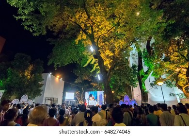 KOLKATA, WEST BENGAL , INDIA - 9TH MAY 2017 : Female singer performing and seen in a giant screen , at Rabindra Jayanti celebration (birthday of Late Nobel winner Poet Rabindranath Tagore).