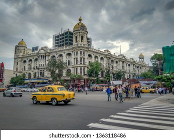 Kolkata, West Bengal / India - April 7, 2019: Cityscape, traffic of a notable city road near Esplanade with a yellow taxi at Chowringhee area, Kolkata ( Calcutta ), West Bengal, India