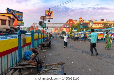 Kolkata, West Bengal/ India - August 11,2019. People slipping on their Hand Pulled Cart overlooking the  exterior view of Howrah Station building with City Traffic.