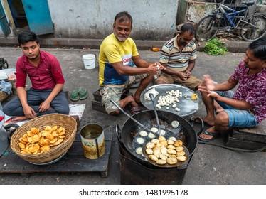 Kolkata, West Bengal/ India - August 12,2019. Group of Unidentified Men selling Alu/Potato stuffed Puri/ Kachodi at Terreti Bazaar, Kolkata.