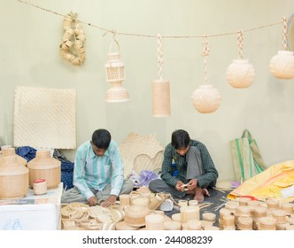KOLKATA, WEST BENGAL , INDIA - DECEMBER 12TH 2014 : Unidentified persons making Cane furnitures , handicrafts on display during the Handicraft Fair in Kolkata - the biggest handicrafts fair in Asia.
