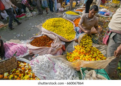 KOLKATA, WEST BENGAL / INDIA - FEBRUARY 13TH, 2016 : Buying and selling of flowers in crowded and colorful Mallik Ghat or Jagannath ghat flower market in Kolkata. Biggest flower market in Asia.