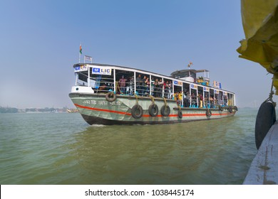KOLKATA, WEST BENGAL , INDIA - JANUARY 18TH 2015 : A ferryboat carrying passengers over river hoogley (river Ganges or Ganga). It connects Kolkata (Calcutta) and Howrah over water transport.