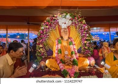 KOLKATA, WEST BENGAL , INDIA - JULY 2ND 2017 : Hindu devotee showing respect with folded hands (Namaskar) to Iskcon member statue , Rath jatra festival.
