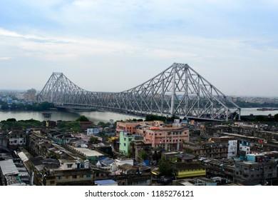 Kolkata, West Bengal / India - July 01 2017: aerial view of the landmark Howrah bridge connecting Howrah with Kolkata over river Hooghly.
