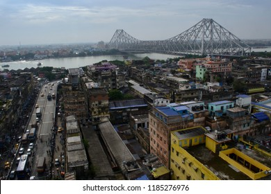 Kolkata, West Bengal / India - July 01 2017: aerial view of the landmark cantilever Howrah bridge connecting two big cities Howrah with Kolkata over river Hooghly.