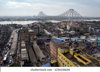 Kolkata, West Bengal, India - July 1, 2017:The skyline shows the famous iconic bridge called Howrah Bridge or Rabindra Setu which connects two cities Howrah and Kolkata or Calcutta over river hooghly.