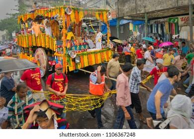 KOLKATA, WEST BENGAL , INDIA - JUNE 29TH 2014 : Devotees dragging ropes Rath (chariot) of God Jagannath, Balaram and Goddess Suvadra as ritual. Iskcon rath jatra festival.