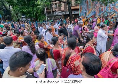 KOLKATA, WEST BENGAL , INDIA - JUNE 25TH 2017 : Devotees dancing spiritually on Rath yatra fetival in Kolkata city. God Jagannath, Balaram and Goddess Suvadra are taken for a chariot ride in city.