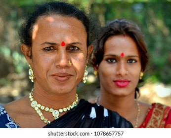 KOLKATA, WEST BENGAL, INDIA - NOV 6, 2014: Two dressed-up East Indian genderqueer street workers (hijra people) pose for the camera, on Nov 6, 2014.