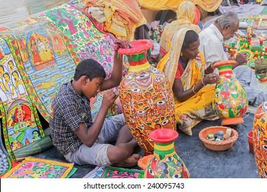 KOLKATA, WEST BENGAL , INDIA - NOVEMBER 23RD 2014 : Unidentified artists painting furniture, handicrafts show during Handicraft Fair in Kolkata - the biggest handicrafts fair in Asia.