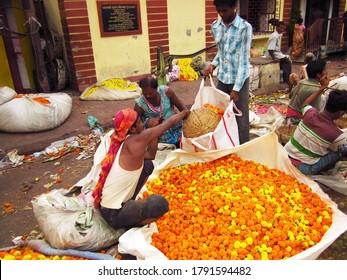 Kolkata, West Bengal - March 29,2013. An unidentified man selling Flower Garland at Mullick Ghat Flower Market.