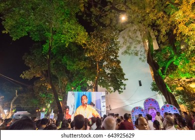 KOLKATA, WEST BENGAL,INDIA -9TH MAY 2017: Male singer performing and seen in a giant screen amongst audience , at Rabindra Jayanti celebration (birthday of Late Nobel winner Poet Rabindranath Tagore).