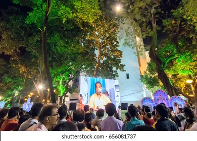 KOLKATA, WEST BENGAL,INDIA - 9TH MAY 2017 : Male singer performing and seen in a giant screen amongst audience,at Rabindra Jayanti celebration (birthday of Late Nobel winner Poet Rabindranath Tagore).