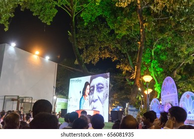 KOLKATA, WEST BENGAL,INDIA - 9TH MAY 2017 : Female announcer seen in a giant screen amongst audience,at Rabindra Jayanti celebration (birthday of Late Nobel winner Poet Rabindranath Tagore).