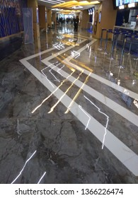 Kolkata, West Bengal/India - December 22, 2018: Shining and designing new marble floor view with light reflections at the entry of 'INOX' at Madhyamgram, Star Mall.
