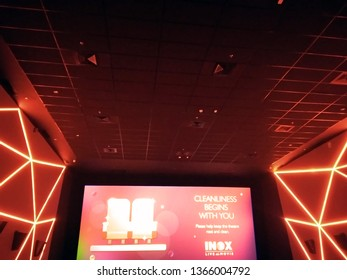 Kolkata, West Bengal/India - December 23, 2018: Red hall wall's and roof design display under dim light with movie screen inside INOX movie hall at Madhyamgram, Star Mall.