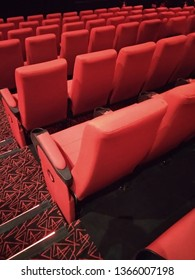 Kolkata, West Bengal/India - December 23, 2018: Red seats or chairs and floor design display under dim light inside INOX movie hall at Madhyamgram, Star Mall.