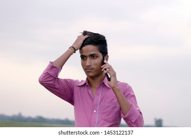 Kolkata, West Bengal/INDIA - July 15 2019: An businessman in tension and talking in the phone.
