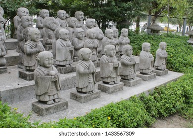 Kolkata, West Bengal/India - June 20, 2019: Little Buddhist monks sculpture all together with nature around at 'Japanese Garden' inside 'Eco Park', Newtown.