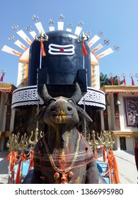 Kolkata, West Bengal/India - October 22, 2017: Famous Hindu god 'Shiv Thakur' display with his conveyance 'Ox' in front on afternoon.