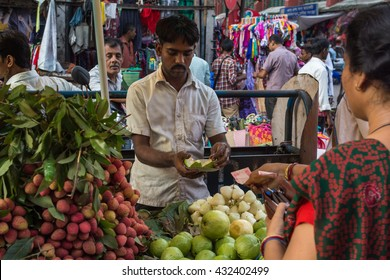 KOLKATA,INDIA - 21 May 2016 : A man selling his fruit on a street vendor in Kolkata New Market.