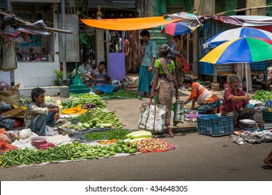 KOLKATA,INDIA - 22 May 2016 :An unidentified Indian selling agricultural product in street market.