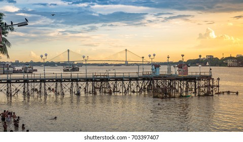 KOLKATA,INDIA, AUGUST 24,2017: Old abandoned jetty on river Hooghly at sunset overlooking the famous Vidyasagar bridge at the backdrop. Photograph taken from Mallick ghat Kolkata.