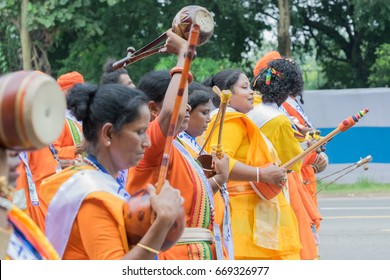 KOLKATA,WEST BENGAL / INDIA- AUGUST 15TH, 2016:Female Bauls, the local music minstrels of Bengal, marching past in India's Independence day rally, with musical instruments in their hands.A joyful day.
