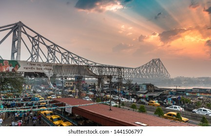 Kolkata,West Bengal India. March 04,2019. Wide view of Historic Howrah bridge or Rabindra Setu at the time of Sunrise with Traffic.