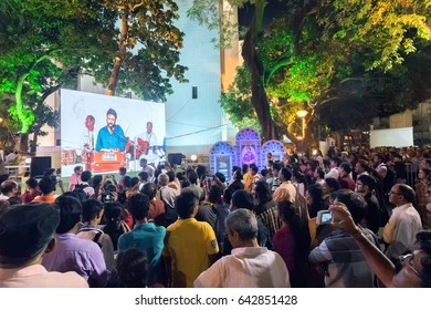 KOLKATA,WEST BENGAL, INDIA-9TH MAY 2017 : Male singer performing and seen in a giant screen amongst audience , at Rabindra Jayanti celebration (birthday of Late Nobel winner Poet Rabindranath Tagore).