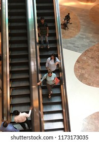Kolkata,West Bengal,India - August 22nd ,2018 Woman descending by escalator stairs in a shopping mall