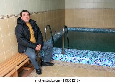 Kolki, Volyn / Ukraine - March 17 2010: Man in jacket posing at sauna