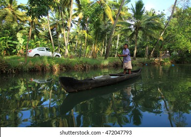KOLLAM, INDIA - AUG 20 : Unidentified villager travels on a wooden boat through the backwater canals of Manroe Island on August 20, 2016 in Kollam,Kerala, India.