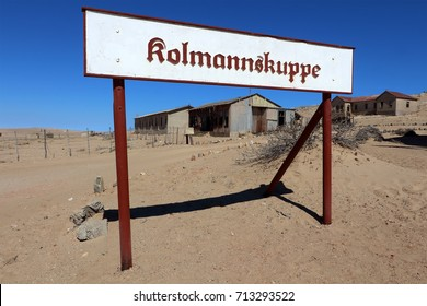 KOLMANSKOP, NAMIBIA - 10 AUGUST 2017: Sign at the entrance to Kolmanskop, Namibia. Kolmanskop is an abandoned mining town near Luderitz, now a popular tourist destination. Editorial.